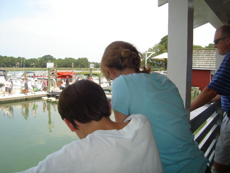 Back of heads at marina
