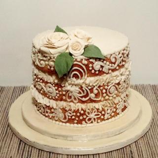 Praline cake with Frangelico infusion and dark chocolate ganache